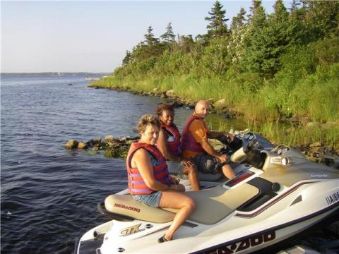Host and Guests Returning From a Seadoo Ride
